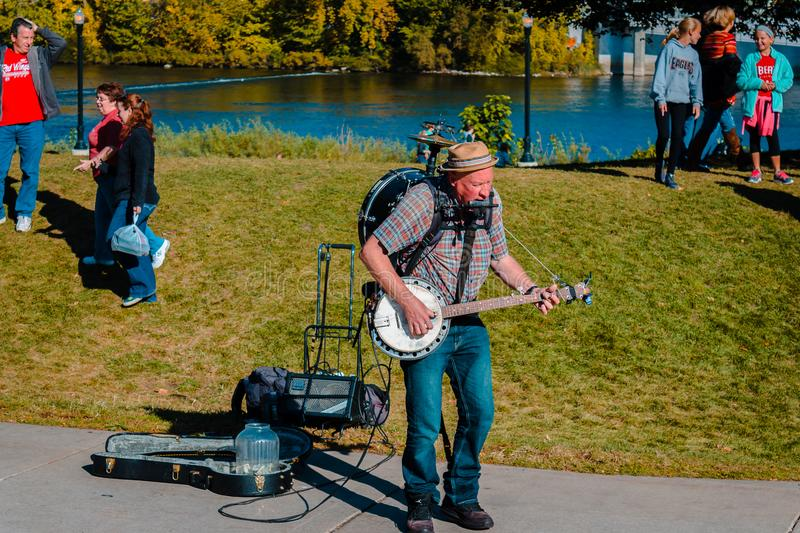One man band performing in Grand Rapids Michigan during Artprize. On a sunny autumn day stock photos