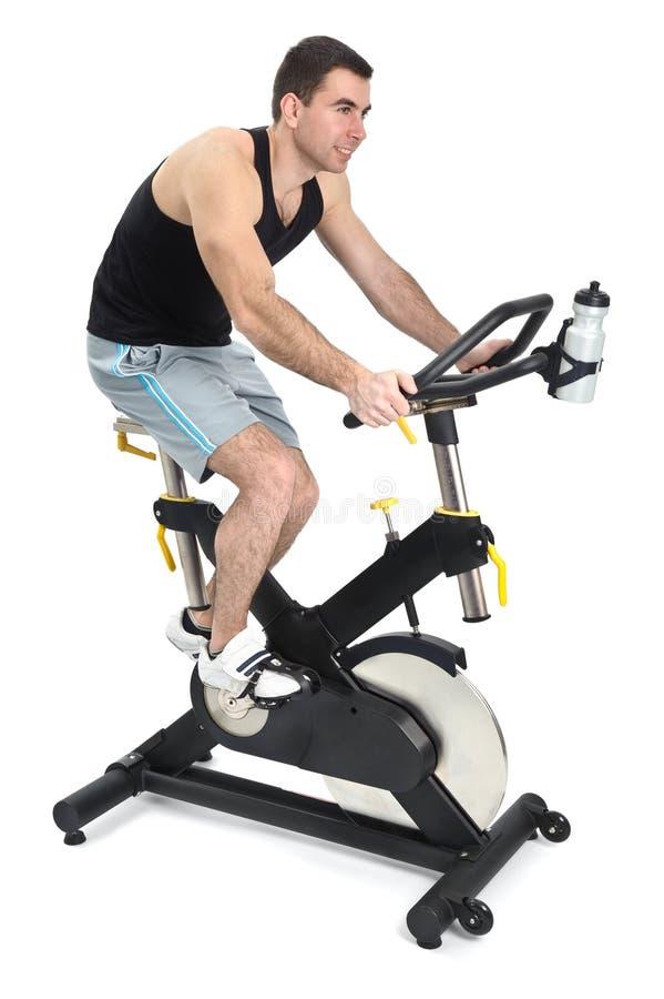 One man doing indoor biking exercise stock image