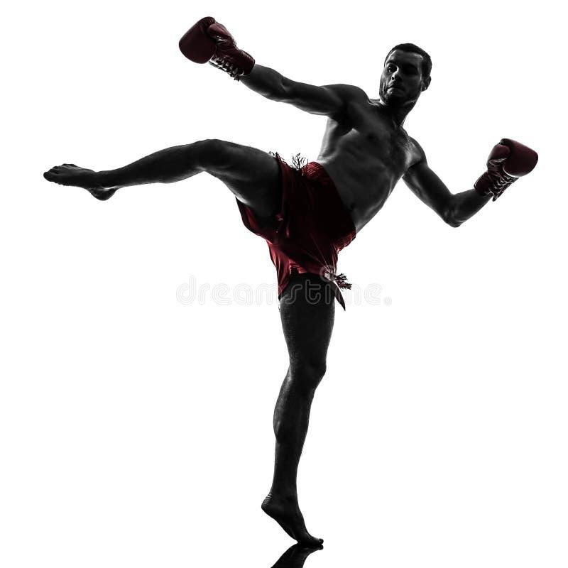 One man exercising thai boxing silhouette royalty free stock image