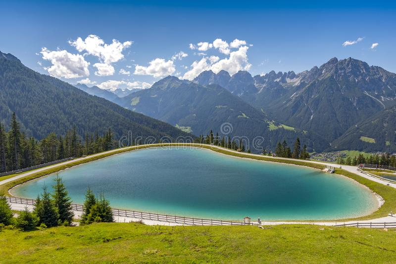 One of the man made lakes near Serles Park next to the mountain station, Mieders, Austria.  stock image