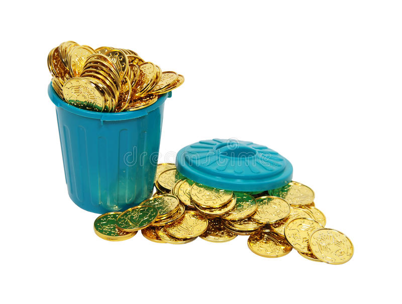One man's garbage is another's treasure. One man's garbage is another man's treasure shown by a rubbish can full of gold coins - path included stock image