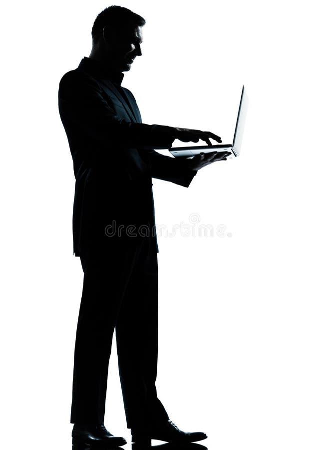 One man silhouette computing computer