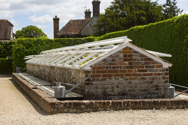 One of many brick built cold frames in the famous walled garden in West dean estate in West Sussex in the South of England. One of many original brick built cold royalty free stock image