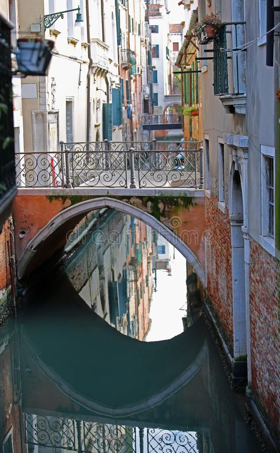 one of the many bridges of the island of Venice in Italy with th stock photography