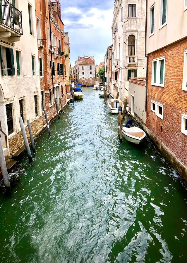 One of the many canals of Venice, Italy stock photos