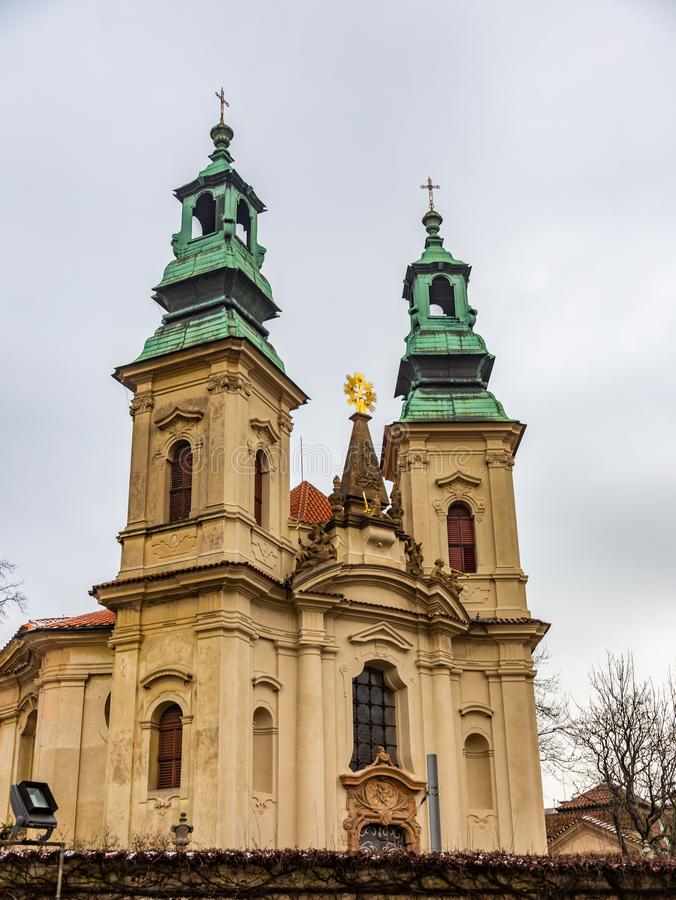 One of the many churches with two spiers in old Prague, Czech Republic stock photography