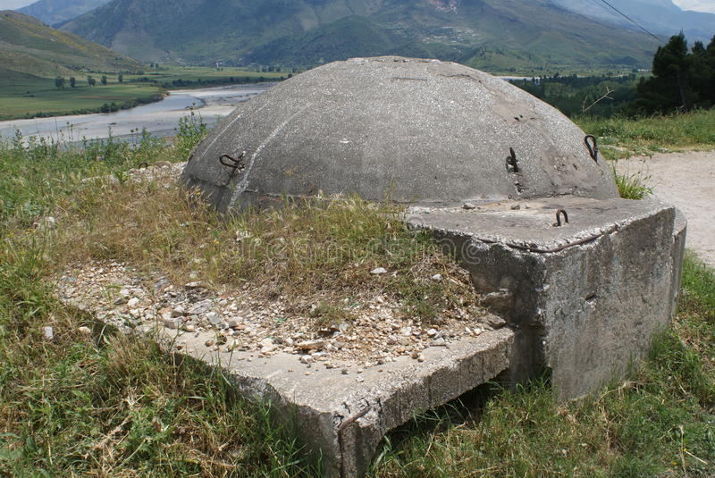 One of many Communist-era bunkers dotting the Albanian countryside. These bunkers were built from the 1960s to the 1980s throughout Albania stock images