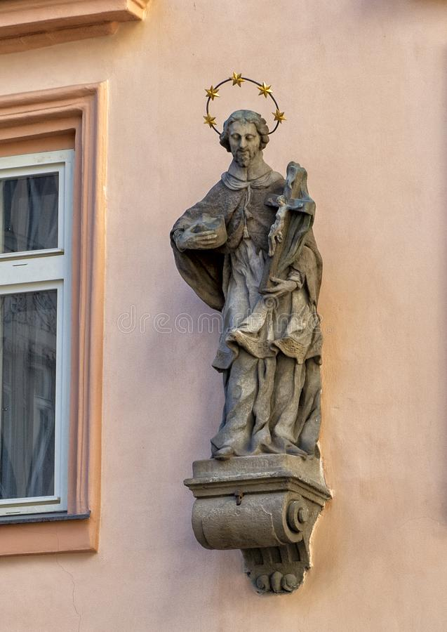 One of many statues of Saint John of Nepomuk in Praque, capital of the Czech Republic. Pictured is one of many stone statues of Saint John of Nepomuk in Prague stock photos