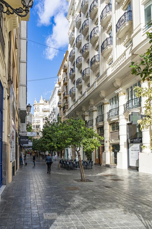 One of the many streets with stately houses with beautiful balconies Carrer d`en Llop in Valencia, Spain royalty free stock photos