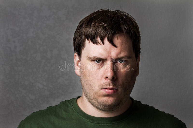 Download One Mean Looking Guy About To Cause Problems Stock Photo - Image of furious, angry: 26008226