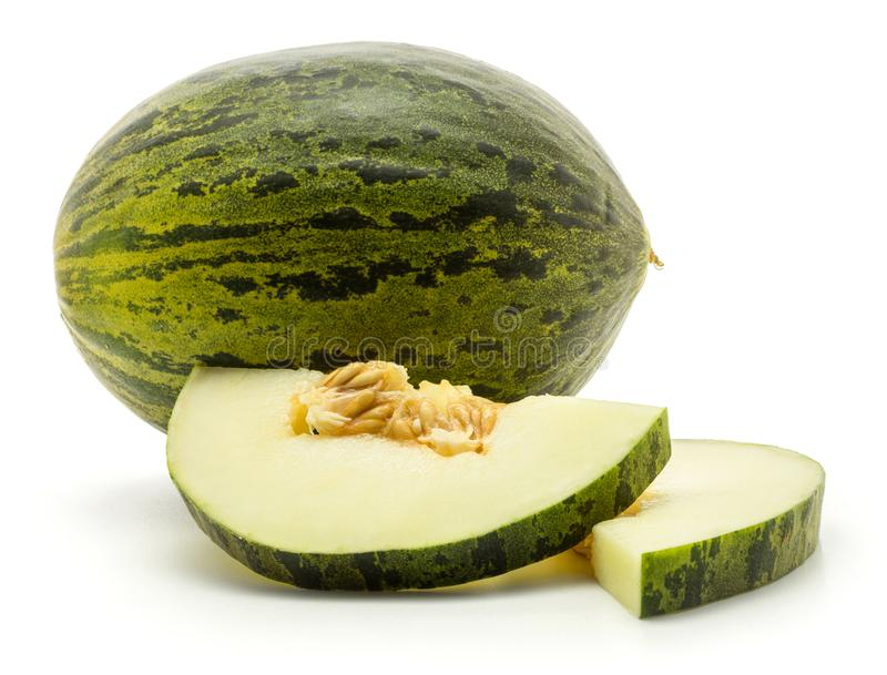 Santa Claus melon isolated on white. One melon Piel de Sapo with two halved round slices Santa Claus Christmas variety isolated on white background with seeds stock photos