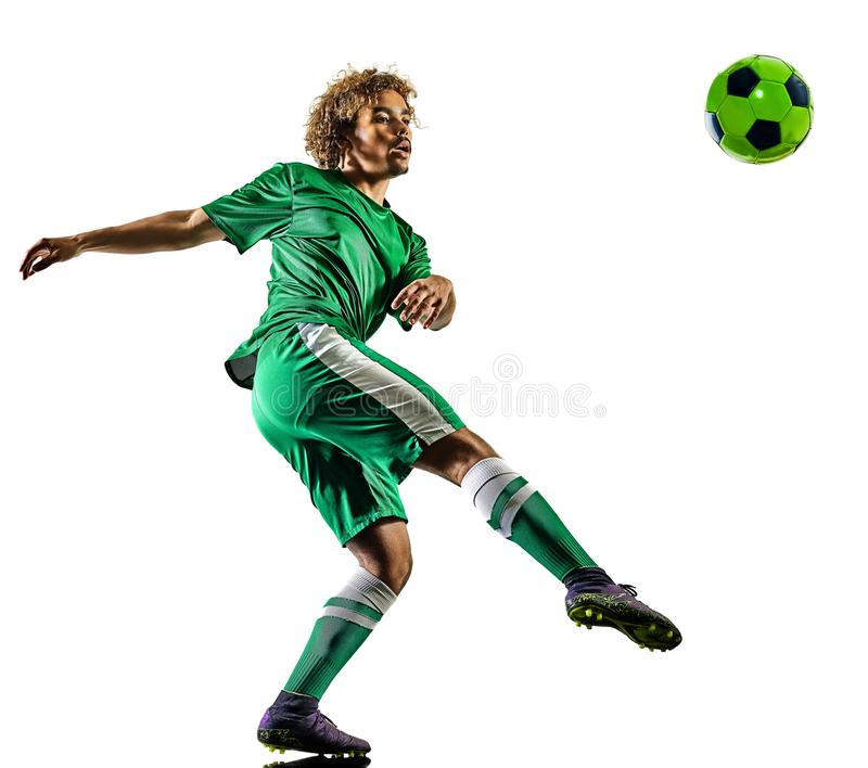 Young teenager soccer player man silhouette isolated. One mixed race young teenager soccer player man playing in silhouette isolated on white background royalty free stock photo