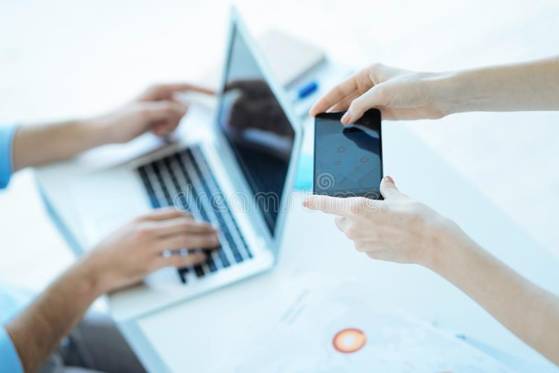 Close up of business people using different gadgets royalty free stock images