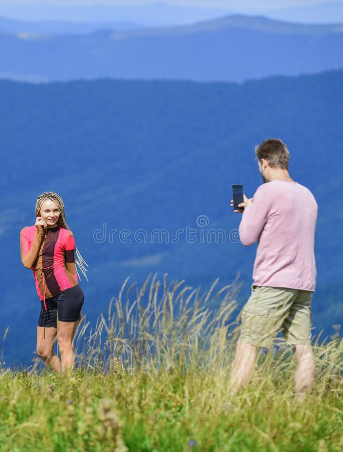 One more shot. Travel together with darling. Couple taking photo. Couple in love hiking mountains. Lets take photo. Snapping memories. Man and woman posing royalty free stock photos