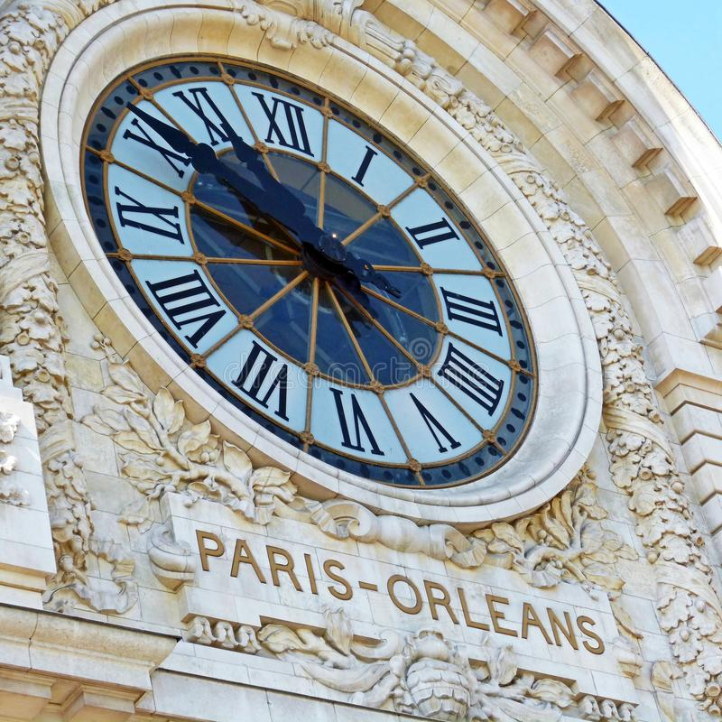 Clock at the front of a building in Paris royalty free stock photos