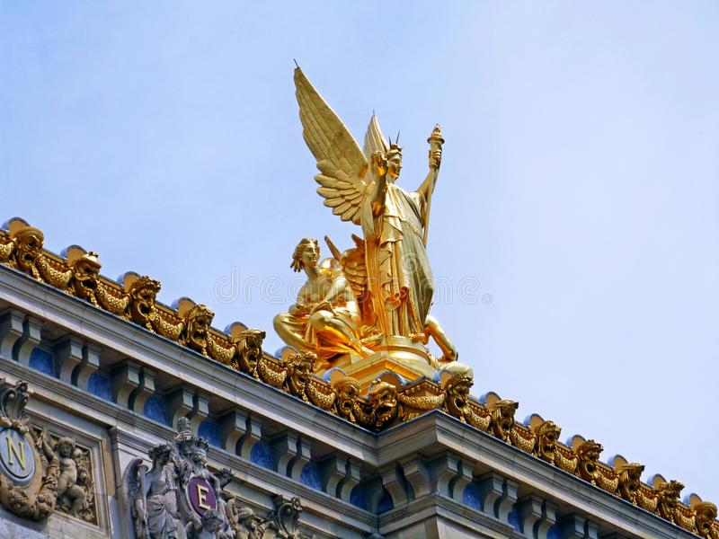 Golden Sculpture looking sky in paris royalty free stock images