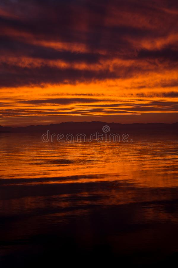RED SKY SUNSET AND GODRAYS IN THESSALONIKI stock photography