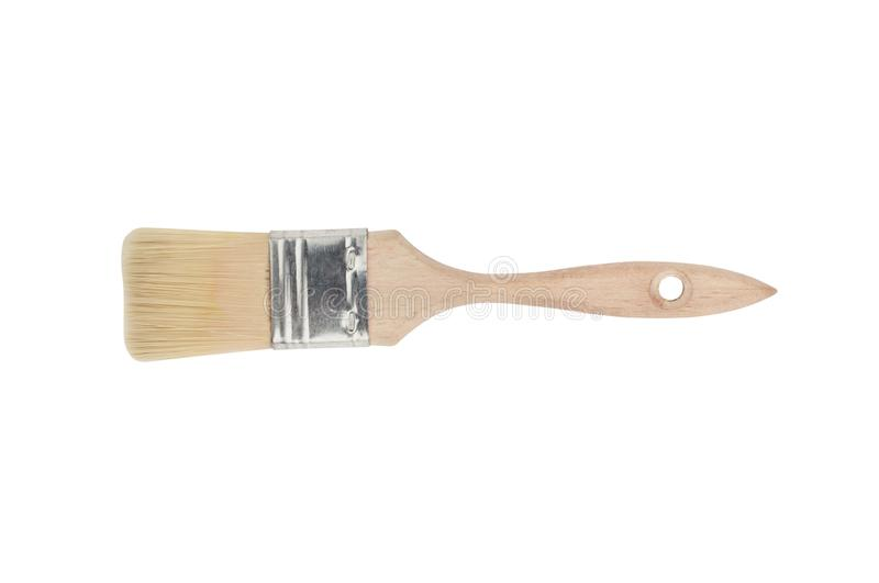 One new clean paint brush with wooden handle and synthetic hairs isolated on white background. Top view stock photo