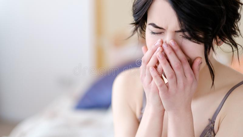 Regret emotional casual sex woman crying bedroom stock photo