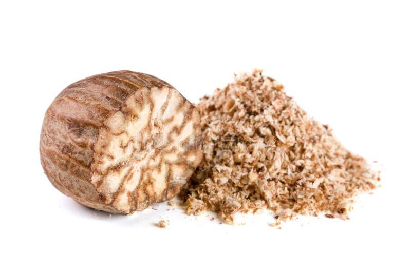 One nutmeg and powder on white background.  royalty free stock photos