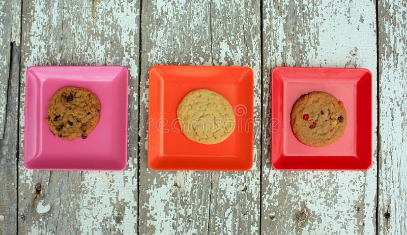 Three Different Colored Square With Plates With Cookies Stock Image ...