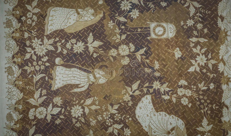 One of old Batik pattern with flowers and people illustration with brown and white color photo taken in Pekalongan royalty free stock photography