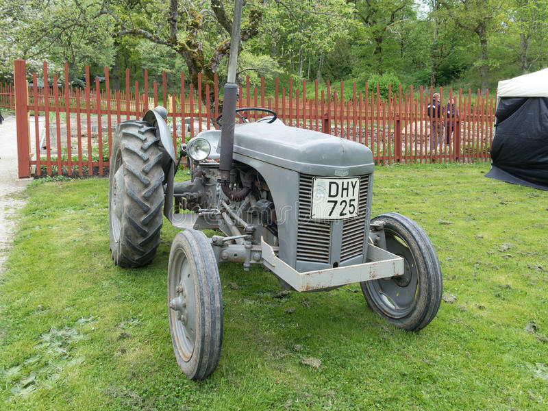 One old and grey tractor beutiful. And ready to work stock images