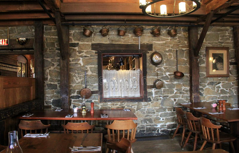 One of the old stone wall dining rooms in the famous Old Bryan Inn Restaurant,Saratoga Springs,New York,2015. Gorgeous stone walls in one of the main dining royalty free stock photo