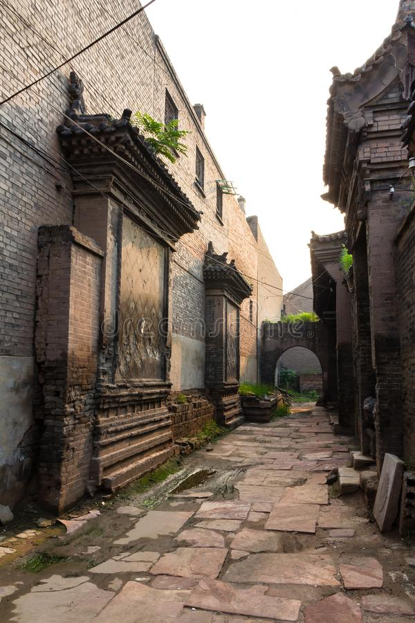 One of the old streets of Pingyao Ancient City, Shanxi province, China. Known as one of the best preserved villages of China, Pingyao is a UNESCO world stock photography
