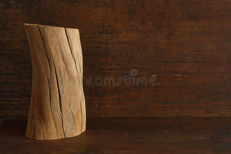 One old wood log with cracks of oak tree on antique wood background with copyspace royalty free stock photo