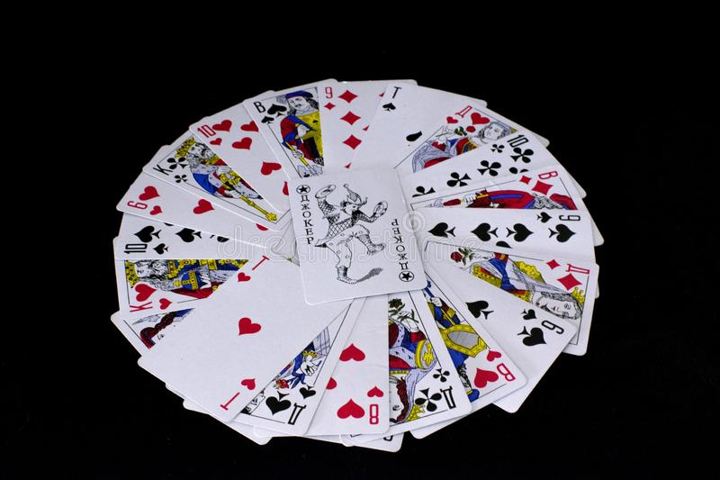 Playing cards on black background. stock images