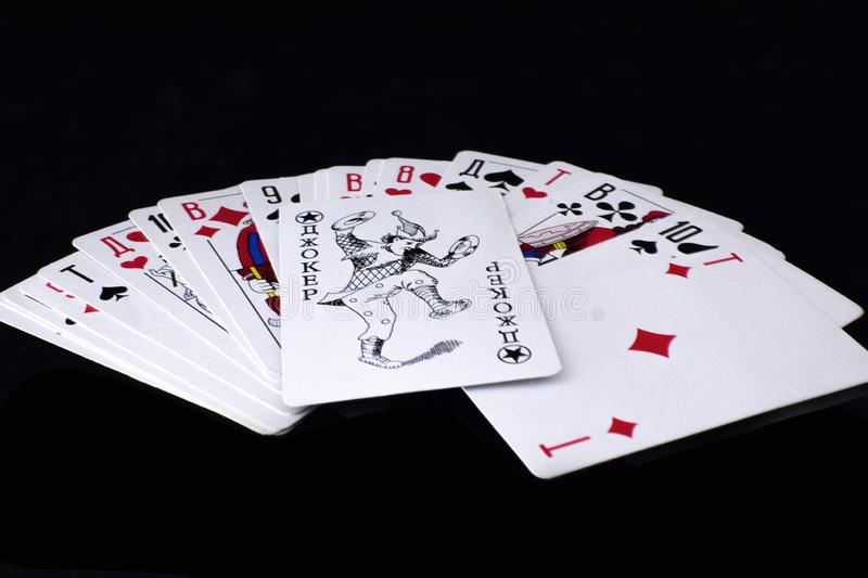 Playing cards on black background. stock photography