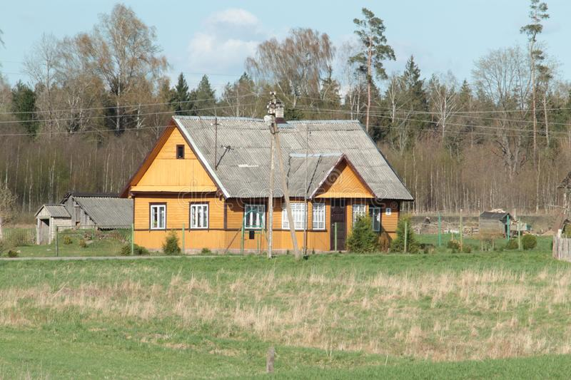 Old wooden orange house in suburb of Vilnius royalty free stock image