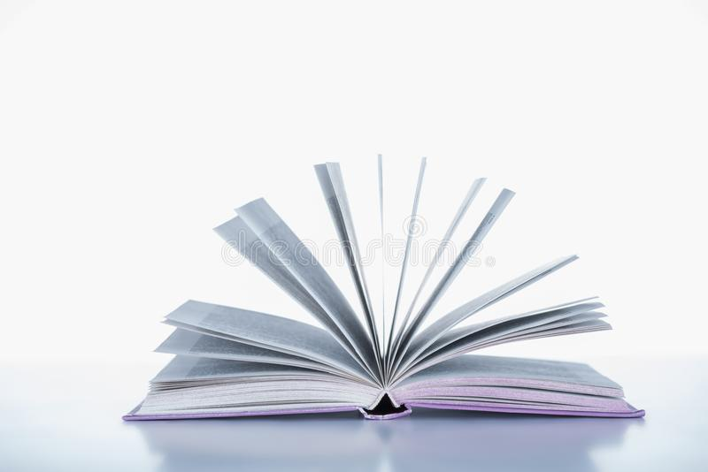 One open book. On white surface stock photography