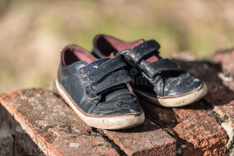 MISSING, abandoned shoes of a child on the street royalty free stock images