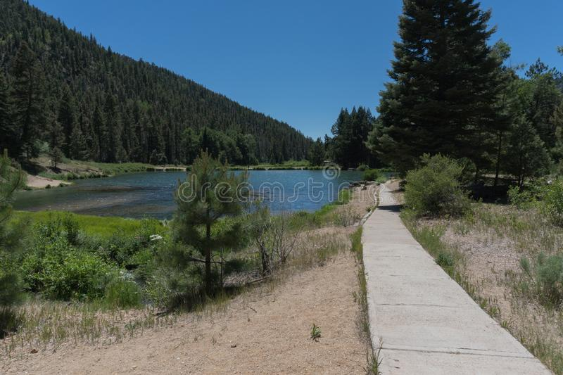 Fawn Lakes pathway in New Mexico. One of the pathways which lead to the small ponds which make up the Fawn lakes in New mexico stock photos