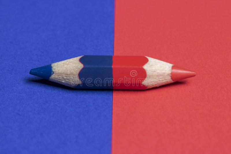 One pencil with red and blue color. Close-up, left and right stock images