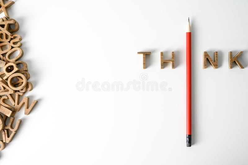 One  Pencil with word think leadership and uniqueness concept. Stand out from the crowd. Think outside the box. Dare to be royalty free stock images