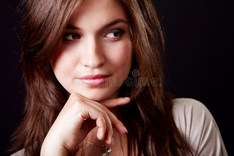 One pensive elegant beautiful woman stock images