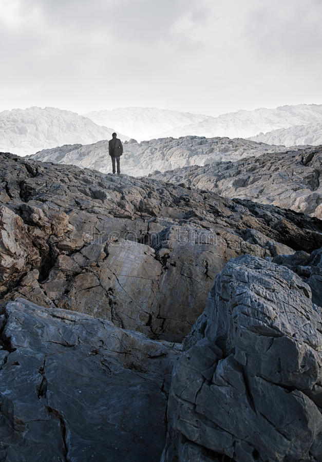 One person alone in the middle of a stone desert royalty free stock image