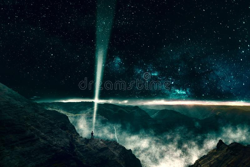 One person sending a light beam signal into outer space. Concept for astronomy, science and technology stock images