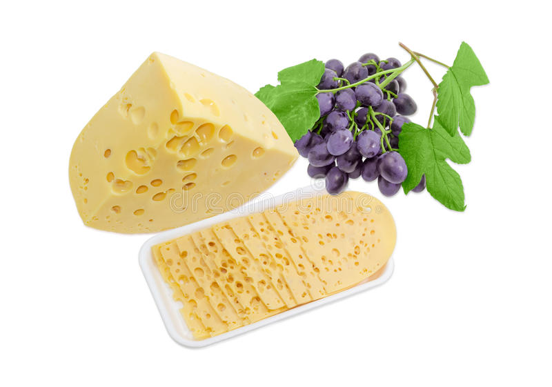 One piece, several slices of Swiss-type cheese and grapes. One piece, several thin slices of the Swiss cheese with cheese's eyes on a plastic tray and bunch of royalty free stock images