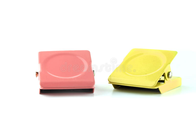 One pink and yellow metal clip royalty free stock image