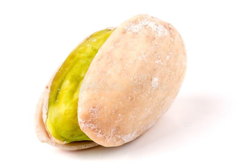 One pistachio on white background close-up macro royalty free stock images