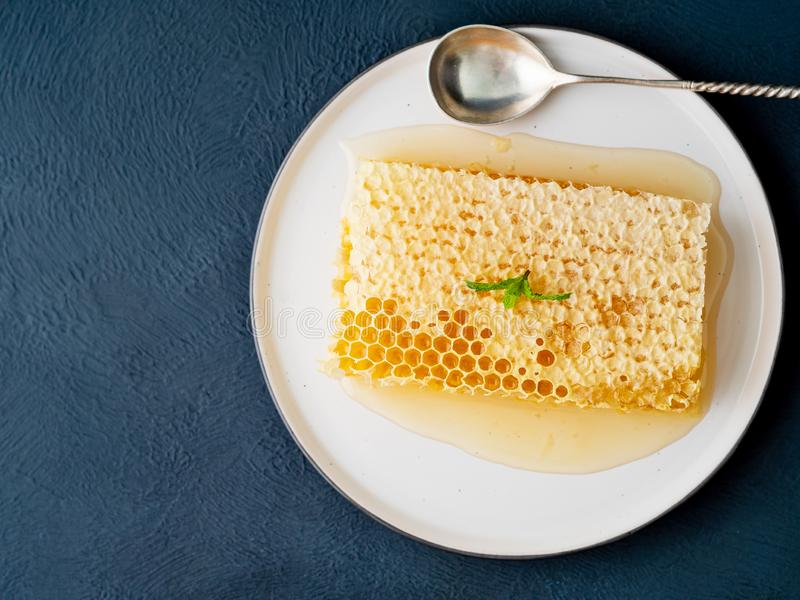 One plate with honey in honeycomb, close-up, on brown ceramic pl stock images