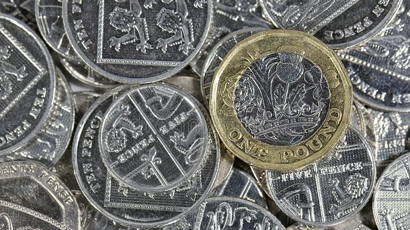 One Pound Coin - British Currency. One pound coin. The new bimetallic coins in a horizontal format introduced as an anti-counterfeiting measure in 2017 stock photos