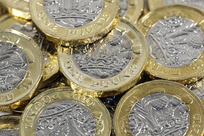 One Pound Coins - British Currency. One pound coins. The new bimetallic coins introduced as an anti-counterfeiting measure in 2017 stock photo