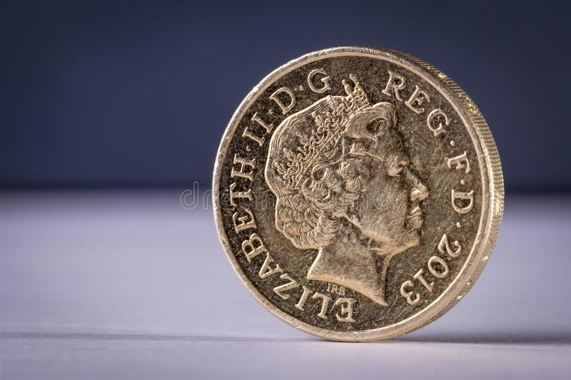 One queen pound uk coin stands plain background stock photos