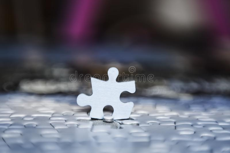 One puzzle piece stand out from the crowd stock photography