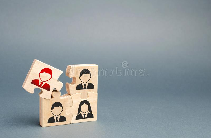 One of the puzzles is disconnected from the overall structure. puzzle with an incompetent and toxic Dismissal of employees, search. For new fresh people to work stock image